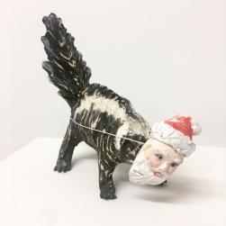 Jennifer McCandless, Last Ditch Effort at Assimilation- Skunk as Santa, stoneware